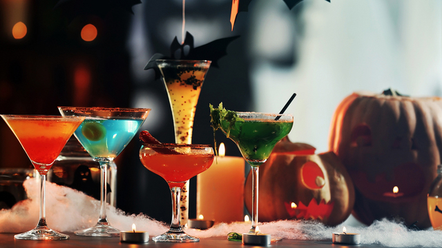 Colorful cocktails and decor for Halloween party, on blurred bac_347696
