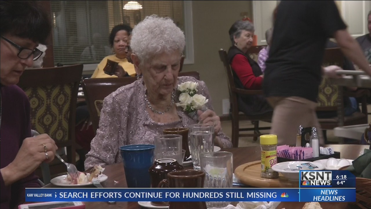 Topeka woman celebrates 100th birthday with cake, rum and coke