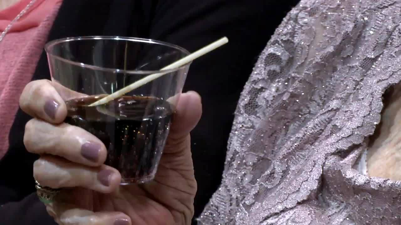Topeka woman says cheers to 100 with a cake and a cocktail