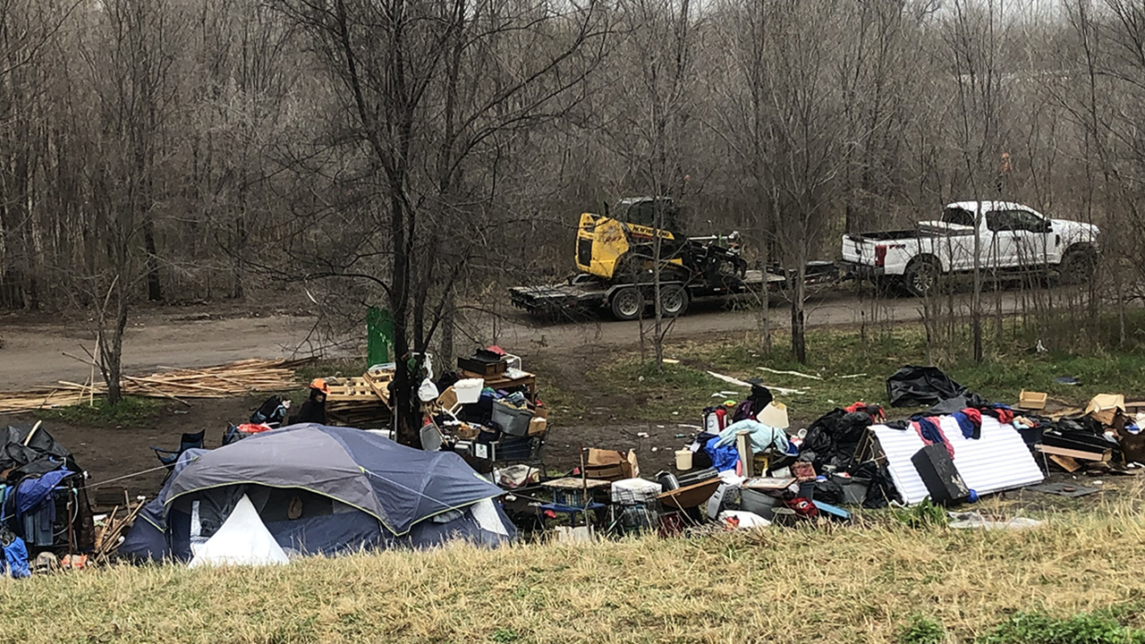 Railroad police, crews clearing out homeless in tent city ...